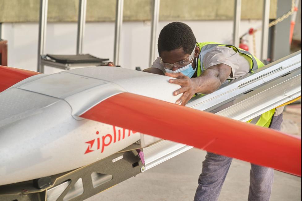 A Zipline Drone Operator Preparing a drone for delivery